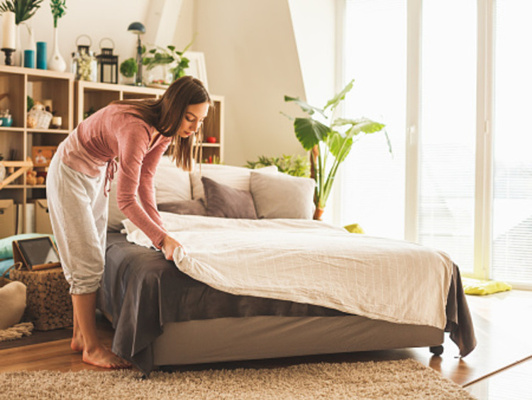 Woman obeys God in the small task of making her bed