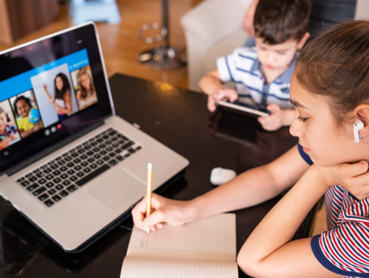 Female student involved in remote learning
