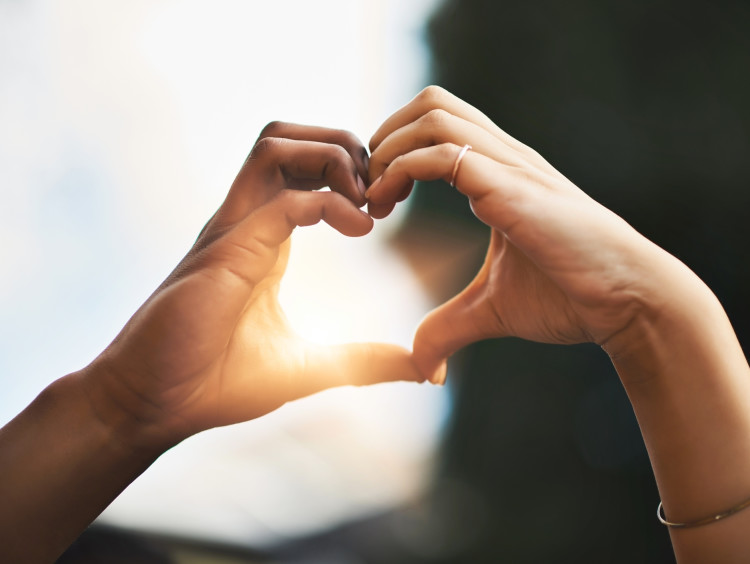 A pair of hands making a heart sign