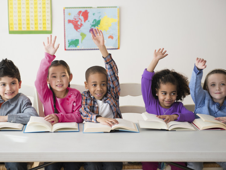 Students reading in the classroom
