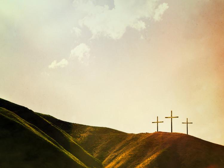 Three crosses on a hillside