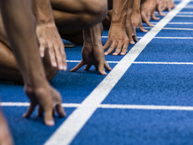 Athletes at the starting line of a racetrack