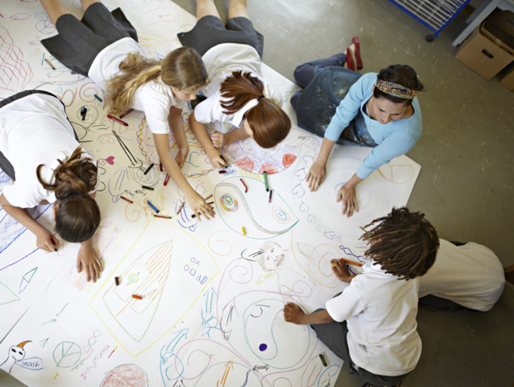 visual learners completing a large drawing together