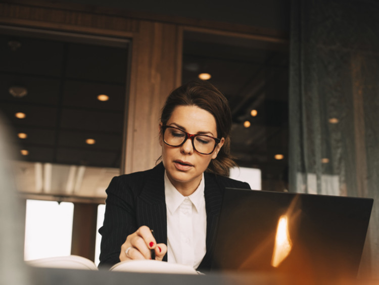 Lawyer sitting at desk with pen and book