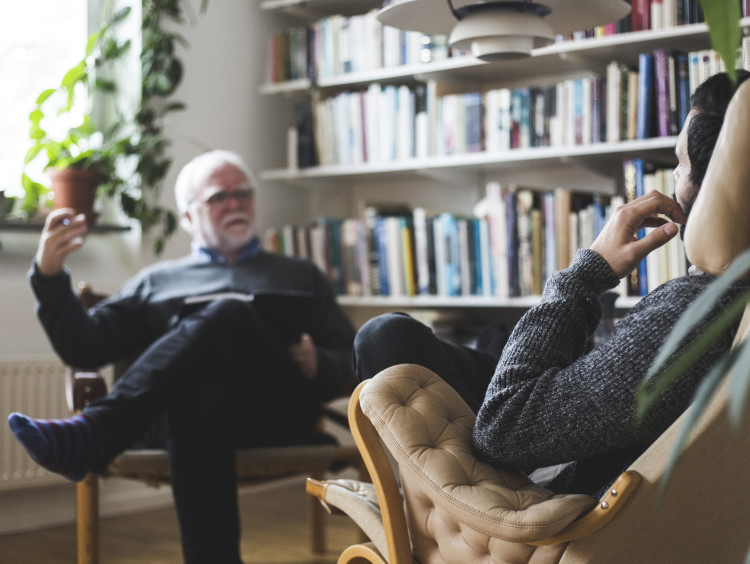 psychologist in chair talking to patient