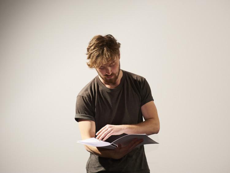 an actor reading a script