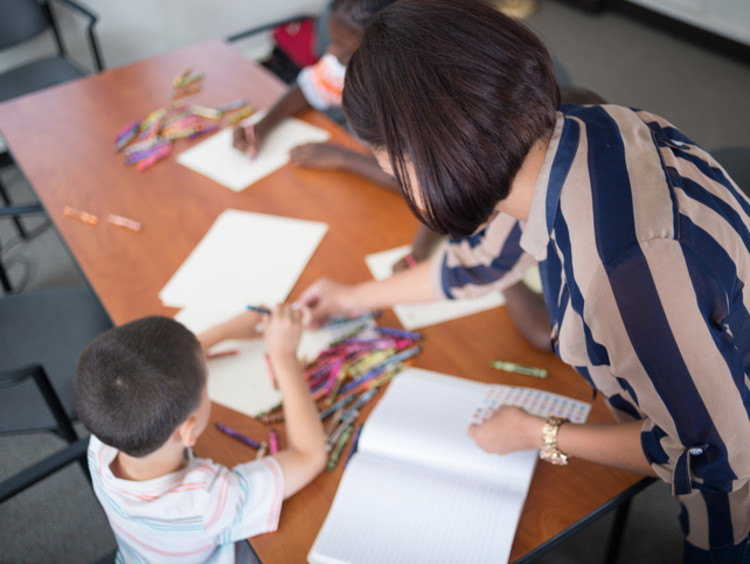 special education teacher drawing with student