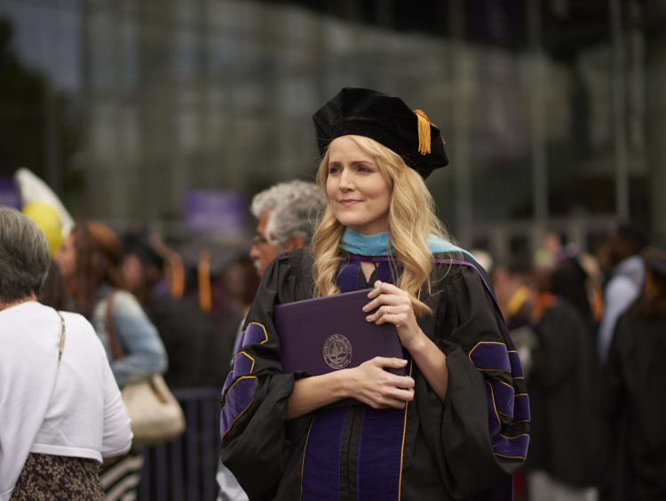 GCU doctoral student with her PhD degree
