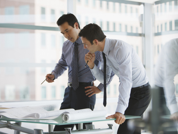 two colleagues working on their decision-making process