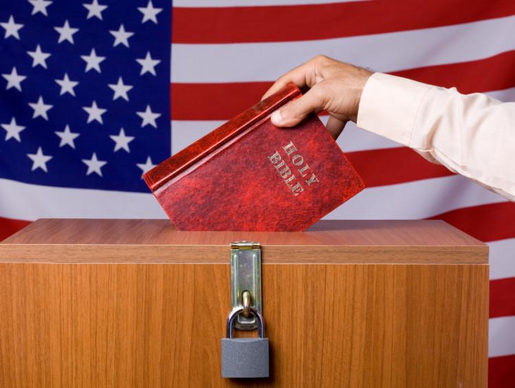 a Chrsitian individual placing their ballot in a voting box