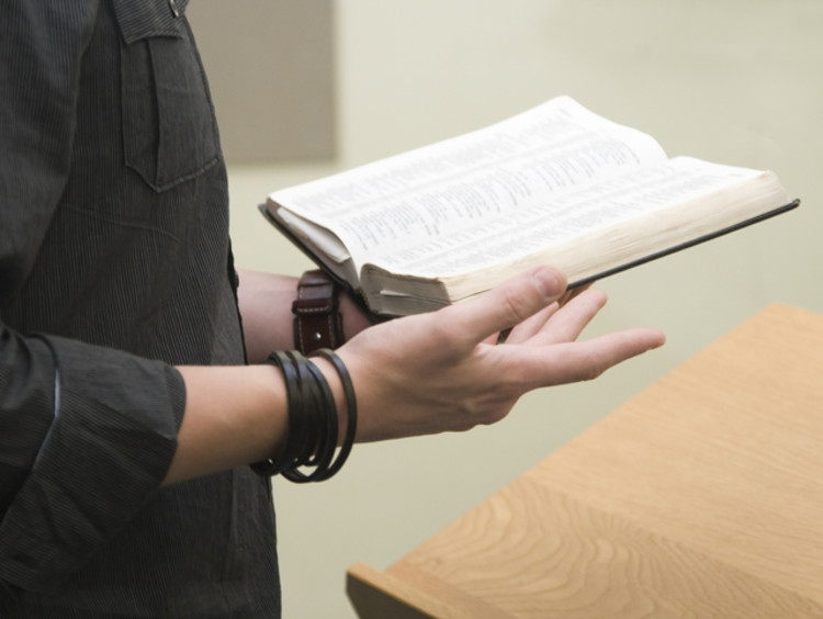 a person reading a bible and learning about christian stewardship