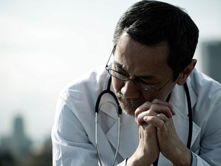 Concerned Doctor Praying