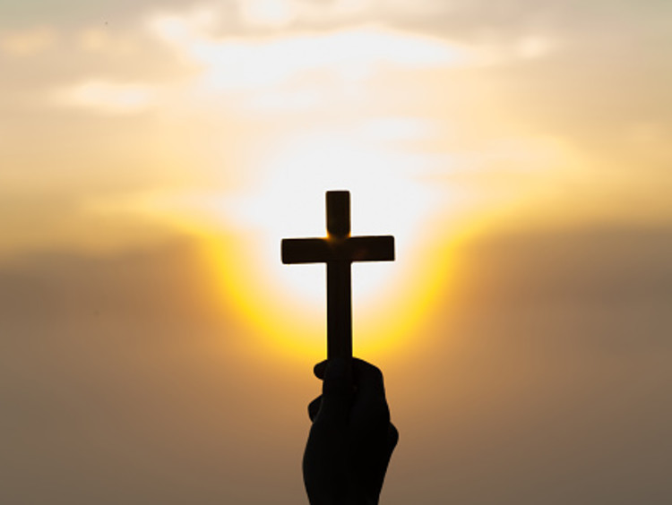 Cross shining light into the world