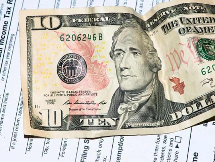 Tax return page and a ten dollar bill