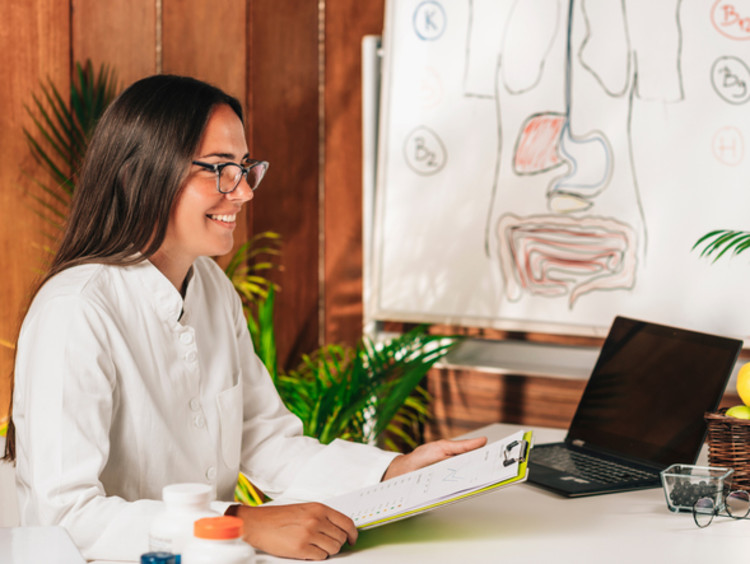 nutritionist working with client in her office