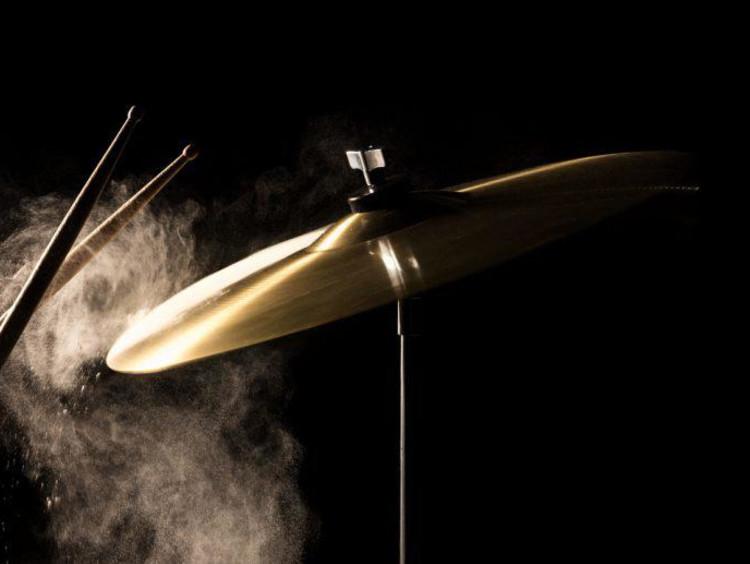 Drum sticks hitting a symbal