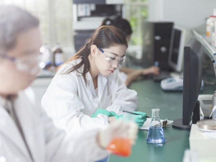 scientists experimenting in a lab