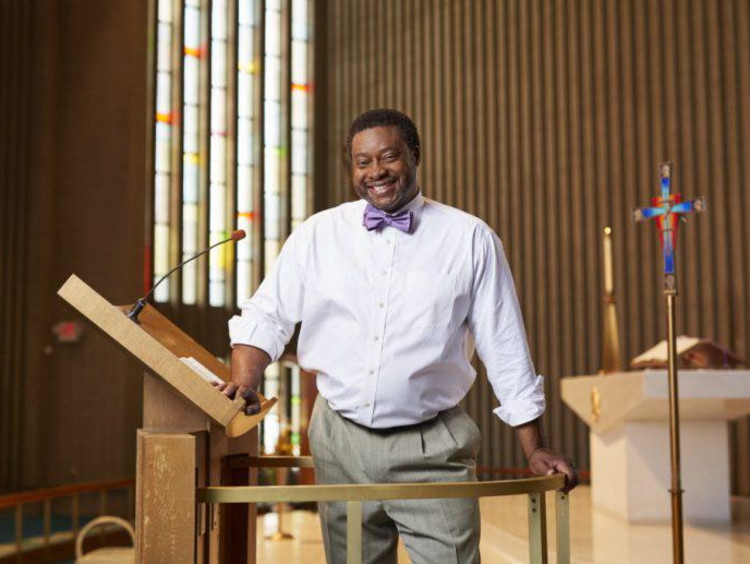 A pastor standing at the front of his church