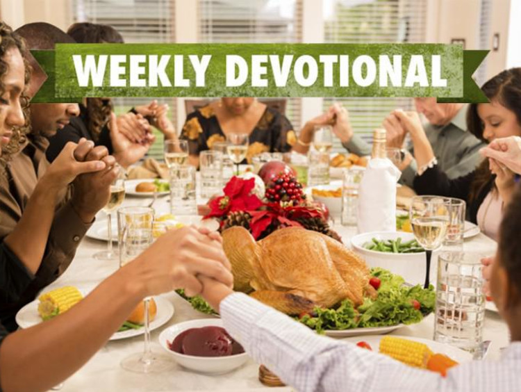A Thanksgiving table with the Weekly Devotional banner