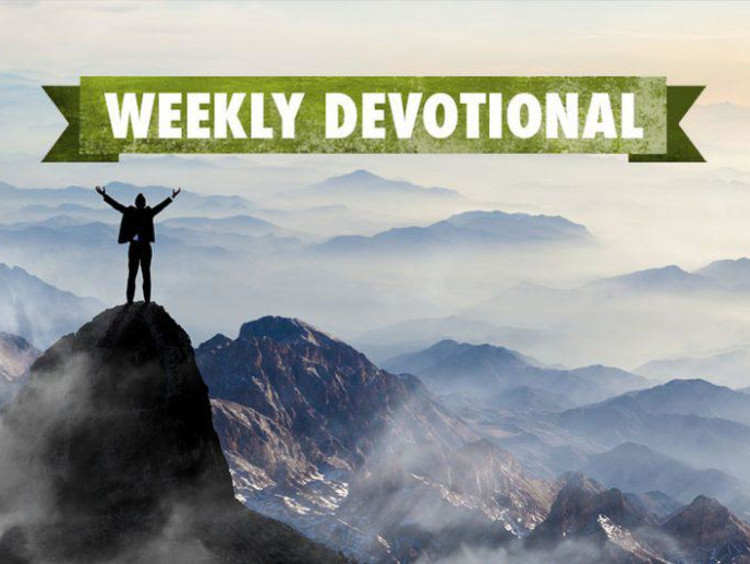 man standing on top of a hill with weekly devotional banner above