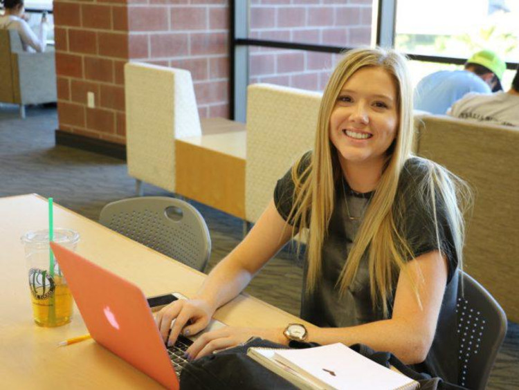 A student studying in the GCU library