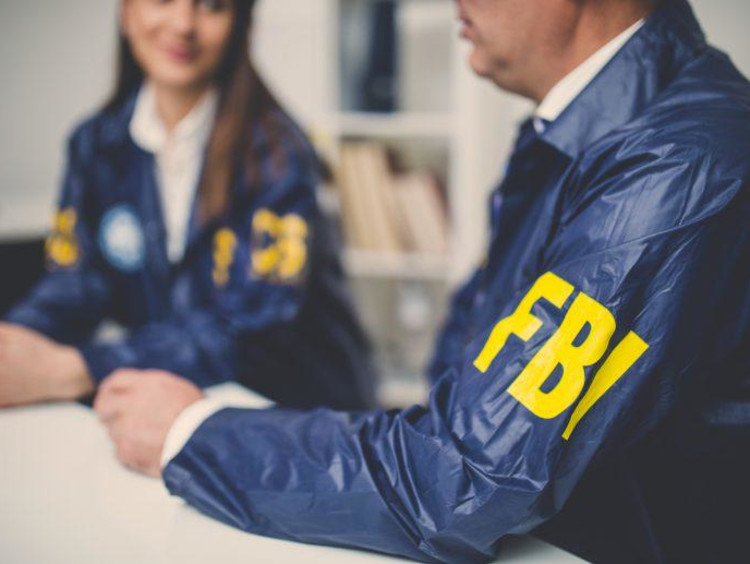 FBI agents sitting together at a table