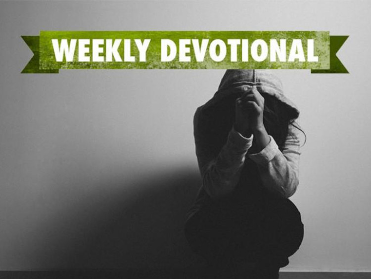 Grayscale image of hooded female in crouched praying position with weekly devotional text