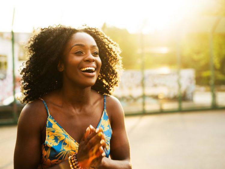 woman smiling and laughing outside