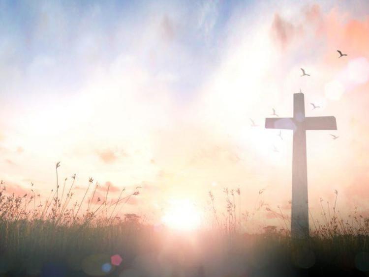 a cross in the sunrise