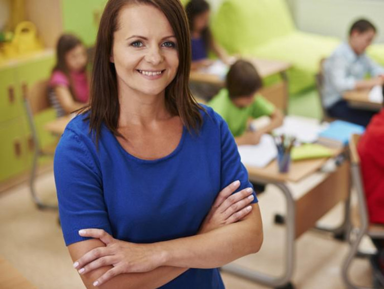 Teacher with crossed arms