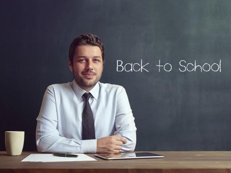 teacher in front of a desk
