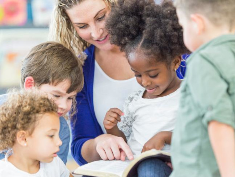 teacher helping children learn