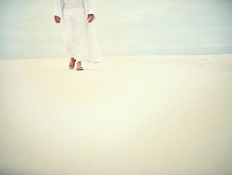 Jesus walking on sand