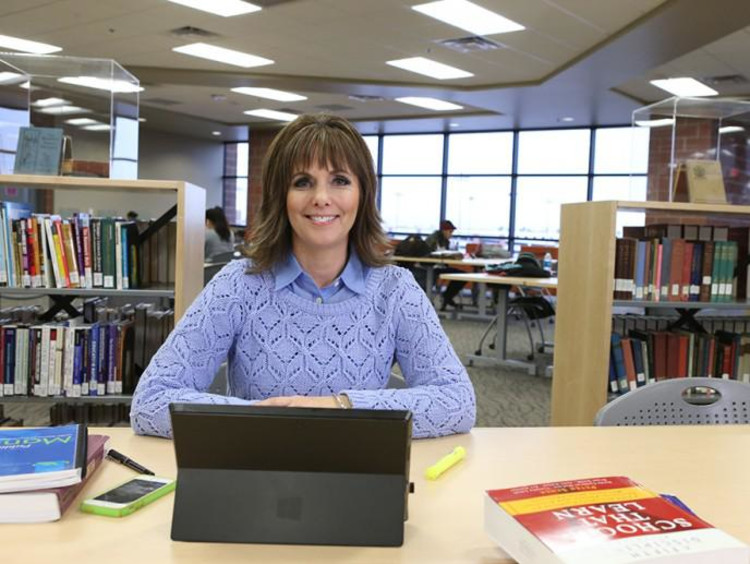 Cathy Ames in a library