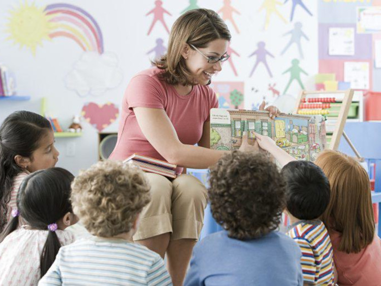 Teacher has interactive reading circle time
