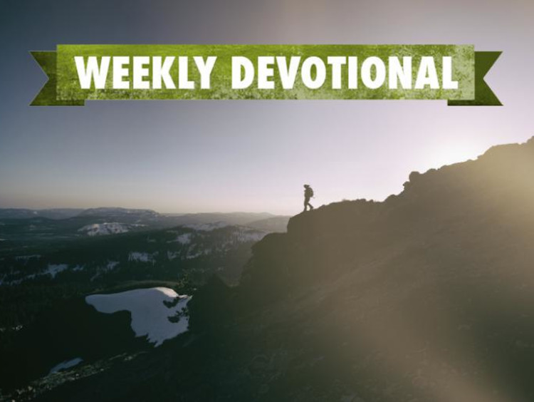 Weekly Devotional: Someone climbing down a mountain
