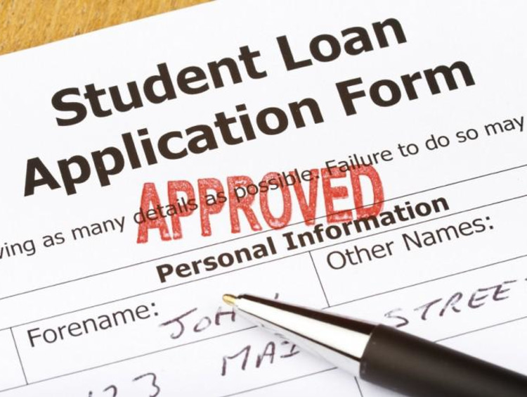 """student loan application form with """"approved"""" stamped on it"""