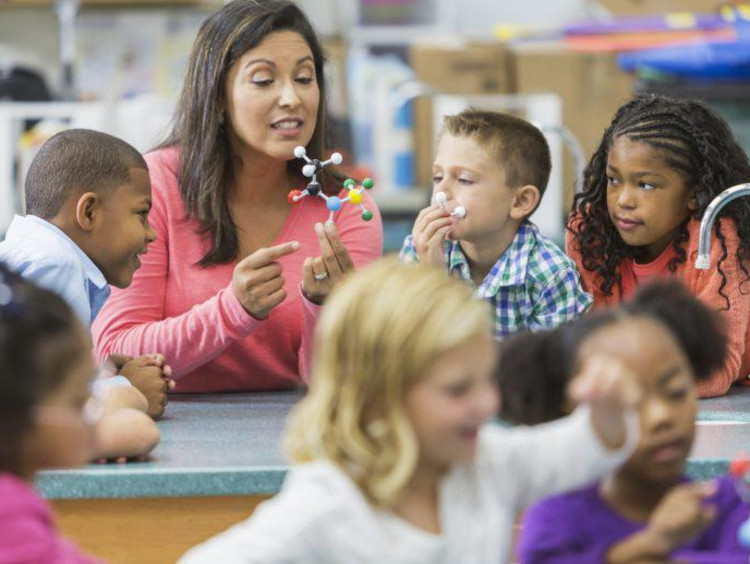 teacher teaching kids in a class