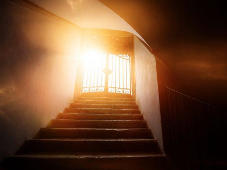 A doorway shrouded in light