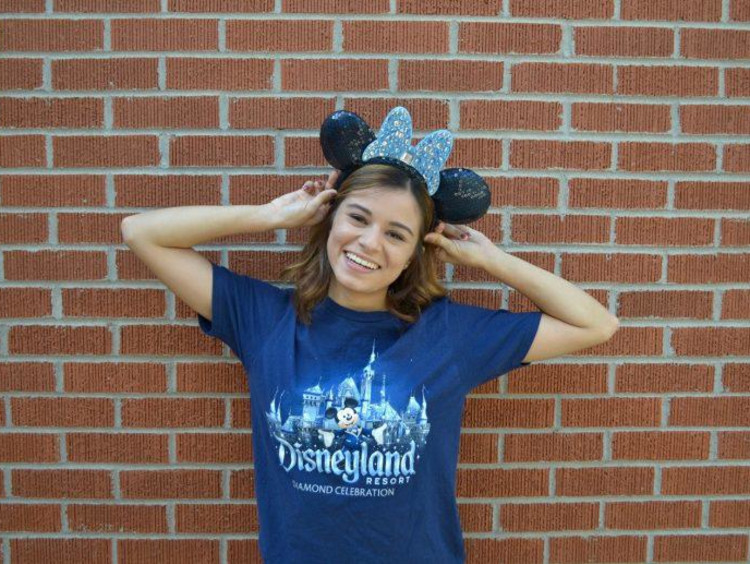 Student poses with Disneyland Resort shirt and Mickey Mouse ears on