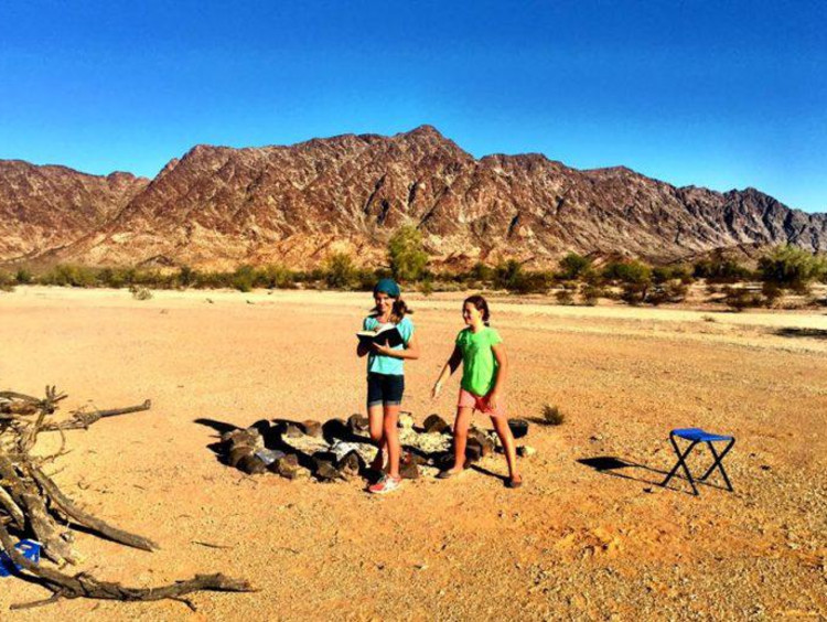 Students playing outside in the desert