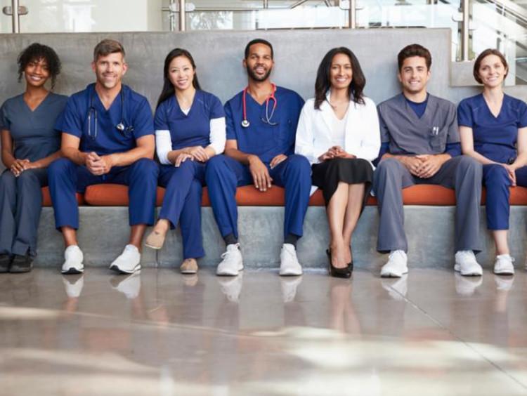 Nurses sitting together on a bench