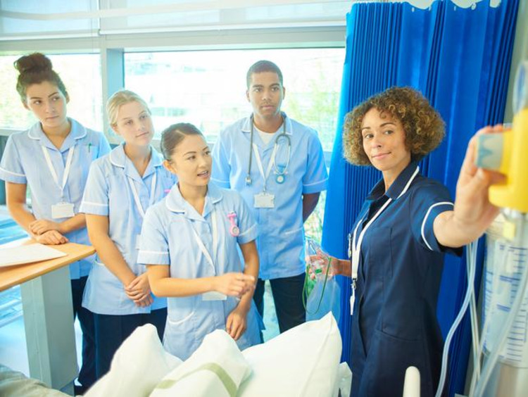 nurses in class learning about equipment