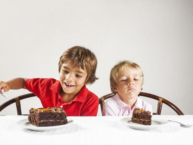 kids eating chocolate cake