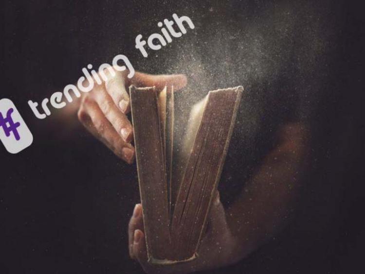 Trending faith logo over a dusty book