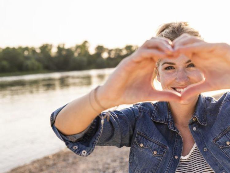 Woman making her hands a heart shape