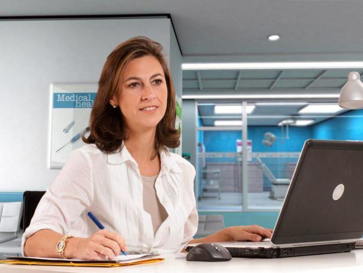 A healthcare admin on a computer