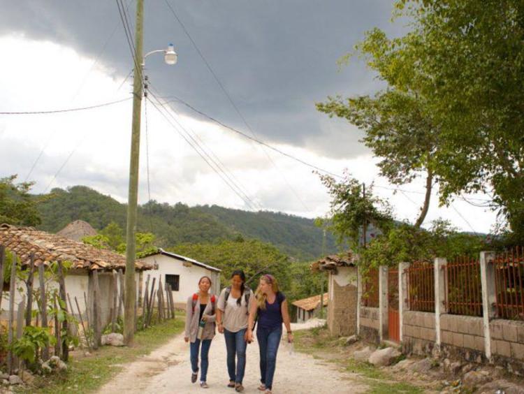 girls walking on dirt path