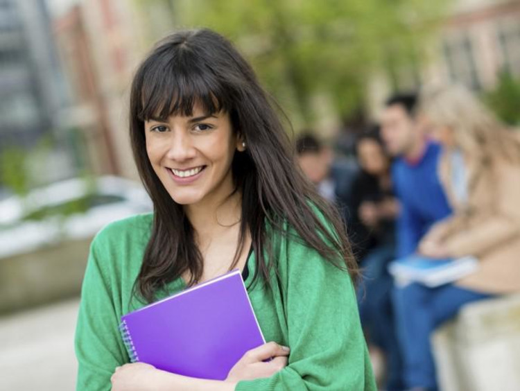 girl holding notebook while walking