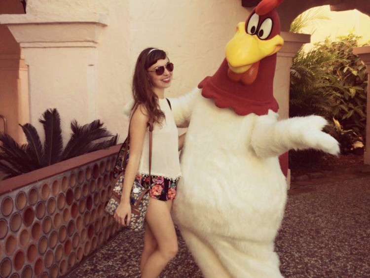 Kaitlyn stands with Foghorn Leghorn in Gold Coast